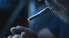 Man lights a cigarette smoker and smokes Stock Footage