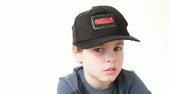 Boy in cap with word Hello on red LED display grieves Stock Footage