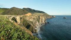 Bixby Creek Bridge and Big Sur coastline at sunset Stock Footage