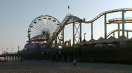 Stock Video Footage of Santa Monica Pier 03: Young family on the beach
