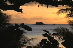 Off shore island at dawn Fiji - stock footage
