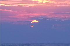 Sun peeps above Atlantic clouds Stock Footage