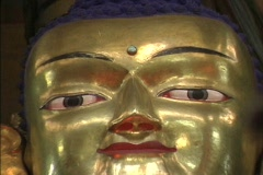Copper-gilt Buddha at Hemis Stock Footage