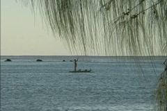 Aitutaki Man on raft Stock Footage