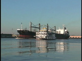 Mississippi freighter passes steamboat LA Stock Footage