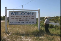 Lousiana Plaquemines Man at sign Stock Footage