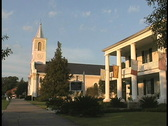 St Martinville Flags and church LA Stock Footage