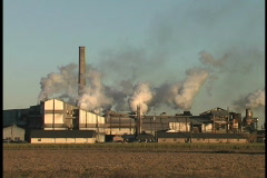 Sugar mill with smoke stacks LA Stock Footage