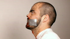 Side View of Man with Duct Tape on Mouth Stock Footage