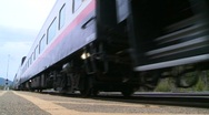 Railroad, passenger train arrives low angle Stock Footage