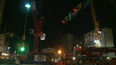 construction, trucks and crane, strobes late night - stock footage