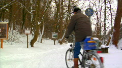 Bicycle driving on snow Stock Footage
