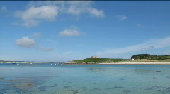 Clouds above Old Grimsby harbour Tresco Isles of Scilly Stock Footage