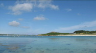 Stock Video Footage of Clouds above Old Grimsby harbour Tresco Isles of Scilly