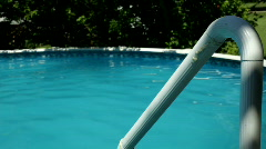 Rail going into Swimming pool on summer day Stock Footage