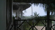 Stock Video Footage of Rain pours down on a tropical beach resort.
