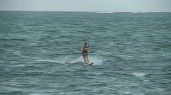 A windsurfer passes by. Stock Footage