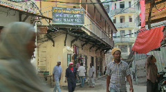 People walk on the streets of Stone Town, Zanzibar. Stock Footage