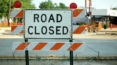 Road closed Sign on city street Stock Footage