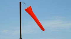 An orange airport windsock, blowing in the wind. Stock Footage