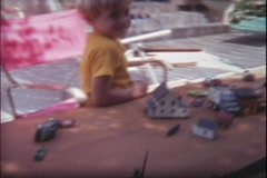 Archive 8mm Family-Kid playing with Toy cars 2 Stock Footage