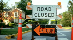 Road closed Detour Sign on Street Stock Footage