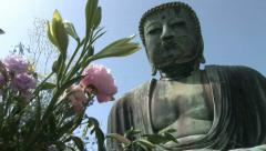 Japanese Giant Buddha in Kamakura 4 - Offering of flowers and fruits. Stock Footage