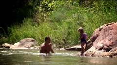 Zion Utah baby jumps and swims Stock Footage