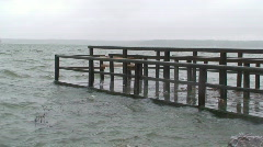 Wooden pier covered by water at storm 1 Stock Footage