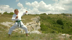 Boy practicing karate on the nature Stock Footage