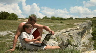 Father and son with laptop Stock Footage