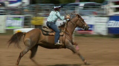 Rodeo Cowboys - Cowgirls Barrel Racing  in Slow Motion - Clip 1 of 5 - stock footage