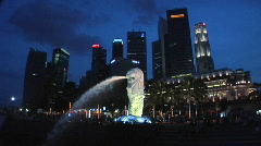 The Merlion at Night with the Financial District as Background Stock Footage