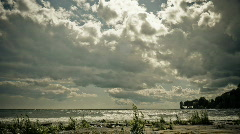Time Lapse of Building Clouds over Shoreline - stock footage