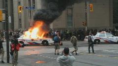 G20 Toronto. Burning police car. Stock Footage