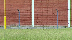 Steel fence in front of the prison Stock Footage