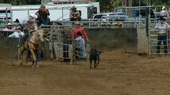 Rodeo Cowboys - Calf Roping in Slow Motion - Clip 4 of 7  - stock footage