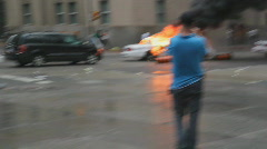 G20 Toronto. Reporter and Burning police car. Stock Footage