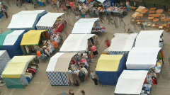 Fair time-lapse - zoom of blur people in the marketplace - stock footage