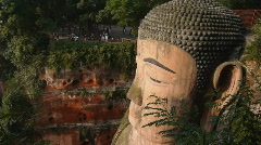 Stock video footage huge statue of Buddha carved into the rock Stock Footage