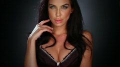 Sexy brunette wearing black lingerie - stock footage