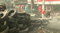 Protesters Build Barricade During Riot Civil War Battle Protest Bangkok 2010   - stock footage