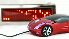 Computer mouse in form of automobile lies beside informational LED display with Stock Footage