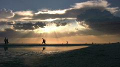 Beach Activity at Sunset Stock Footage