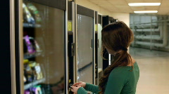 Girl buying from Vending Machine - stock footage