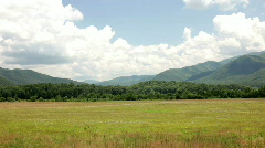 Pan of Cloudy Mountain and Field Stock Footage