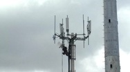 Technician working on top of cellular antenna tower 2 Stock Footage
