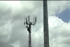 Technician working on top of cellular antenna tower 3 Stock Footage