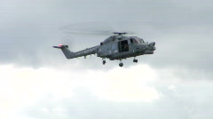 Naval helicpter hovers 001 Stock Footage