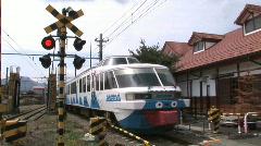 Tourism train for Mount Fuji arrives at Fujikyu Station. Japan.  Stock Footage